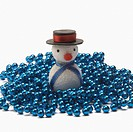 Close_up of a snowman on string of blue beads