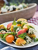 Mozzarella and tomato skewers with basil