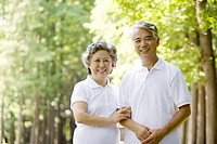 Senior couple arm in arm outdoors