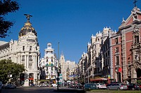 Spain, Madrid, Centro, busy intersection of Gran Via and Calle Alcal&#225;r with Edificios Metropolis and Grassy and the prominent ornamental facade of Igl...