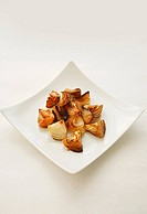 Baked onions on white plate
