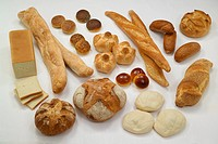 Food. Still life - Italian bread. Top to bottom and left to right: sliced sandwich loaf, ciabatta, sesame, poppy and cumin-seed bagels, rosette, bague...