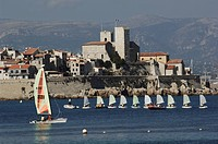 Sailboats in the sea with a town in the background, Antibes, Provence_Alpes_Cote D´azur, France