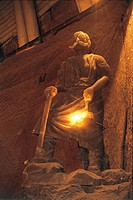 Low angle view of the statue of a miner, Wieliczka Salt Mine, Krakow, Lesser Poland Voivodeship, Poland