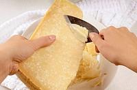 Woman shaving Parmesan with a Parmesan knife