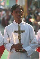 Myanmar (Burma) - Mandalay. Catholic priest holding a cross