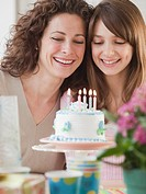 Girl 10_12 years celebrating birthday with mother