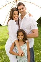 Family, stands, smiling, meadow, embraces, subordinates, parasol