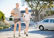 Couple jogging in neighborhood