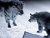 Bull and bear figurines on list of share prices