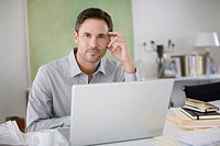 Man using laptop at desk