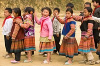 Flower Hmong schoolgirls playing in Cau Son near Bac Ha Vietnam