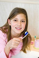 Girl washing her teeth
