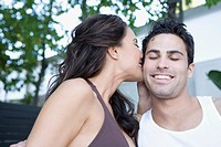 Woman kissing husband outdoors