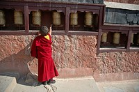 A novice monk spinning the prayer wheels Tiksey, Ladakh, India