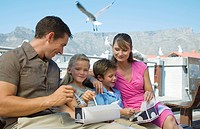 Family enjoying take away at the Waterfront with Table Mountain in background, Cape Town, Western Cape Province, South Africa