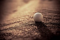 Golf ball in the sand  Foreground