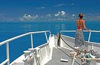 Woman look out over Great Bahama Bank, Bahamas Islands