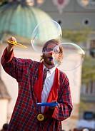 Street performer makes babbles at Main Market Square, Krakow, Poland