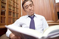 Japanese executive reading a book
