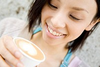 Woman drinking Cafee latte