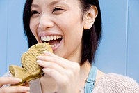 Woman eating a Taiyaki