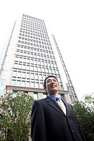 Businessman and a high_rise building