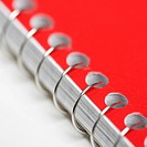 Close up red spiral bound notebook