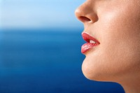 Close up portrait of woman's face with Pacific Ocean in background