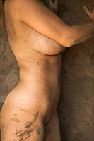 Close up of young womans muddy torso (thumbnail)