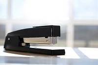 Black stapler with window in background (thumbnail)