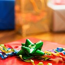 Presents wrapped and decorated with bows on a table