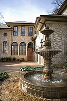 Outdoor front view of affluent home with fountain