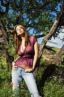 Sexy young Caucasian woman with attitude standing on coastline (thumbnail)