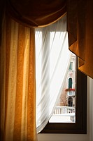 Window with drapes in Venice, Italy
