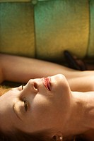 Caucasian mid adult woman lying on back with eyes closed