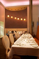 Long table in restaurant with place settings