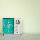 Still life of vintage clock radio with turquois face