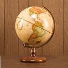 Sill life shot of a vintage world globe sitting on a desk