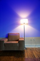 Modern chair and floor lamp with blue cast from projection
