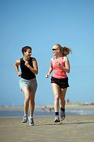 Young women running at the beach