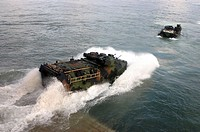 Amphibious assault vehicle splashes off the USS Whidbey Island
