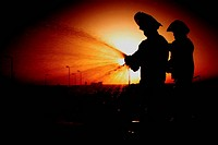 Airmen run an operations check on a fire hydrant hose (thumbnail)