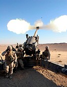 A 155mm high_explosive artillery shell is blasted skyward by the Marines