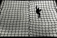 A U.S. Army Soldier_in_training makes her way down a rope ladder during basic training