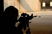 Airman tests his skills at the shooting range