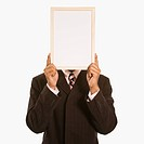 African American man holding blank sign over his face standing against white background (thumbnail)