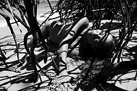 Pretty Filipino nude young woman on beach in tree shadows  (thumbnail)