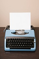 Blank sheet of paper in an old fashioned typewriter