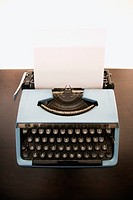 Still life of blank sheet of paper in an old fashioned typewriter (thumbnail)